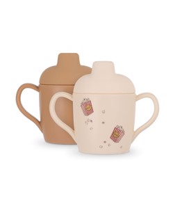 Pack de 2 tasses d'apprentissage bébé en silicone Konges Sløjd | Popcorn/Light Brown | Manipani boutique vaisselle bébé design